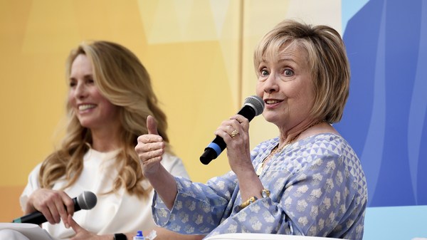 Laurene Powell Jobs interviews Hillary Clinton at OZY Fest in Central Park on Saturday in New York City.