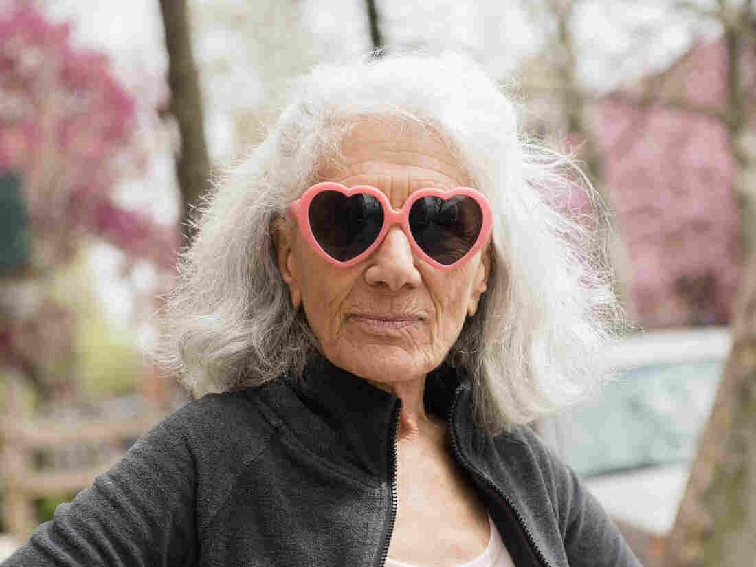 Older woman wearing heart-shape sunglasses