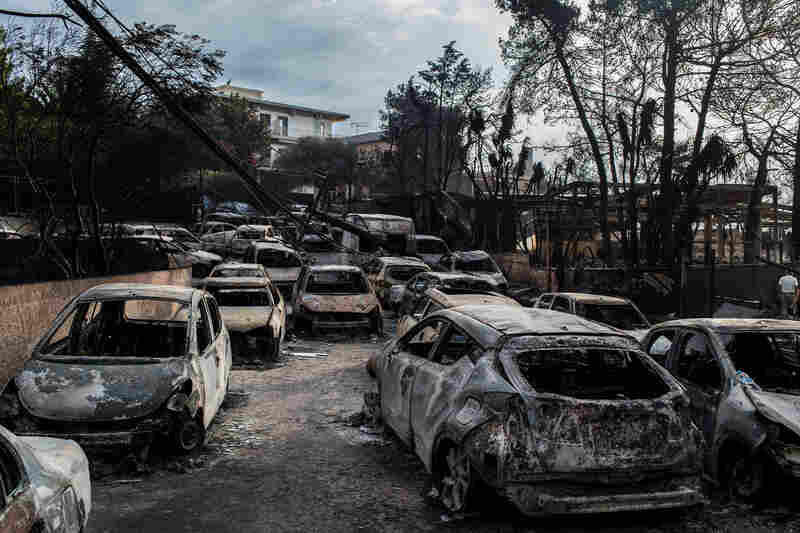 Charred cars lined a roadway in the village of Mati, about 15 miles east of Athens, on Tuesday.