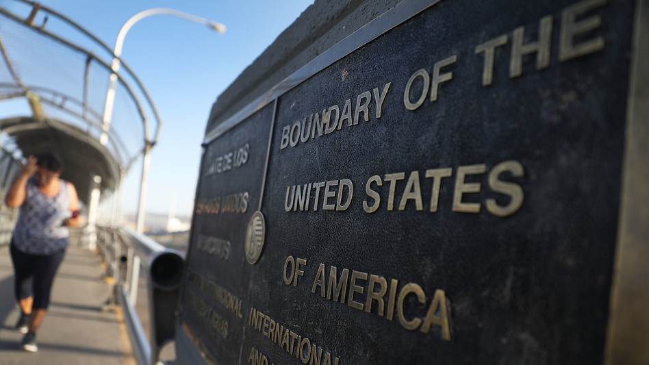 A plaque marks the U.S. border on the Paso Del Norte Port of Entry bridge which connects the U.S. and Mexico on July 23, 2018. As many as 2,551 migrant children ages 5 to 17 were separated from their families after they crossed into the U.S. from Mexico along the border. (Joe Raedle/Getty Images)