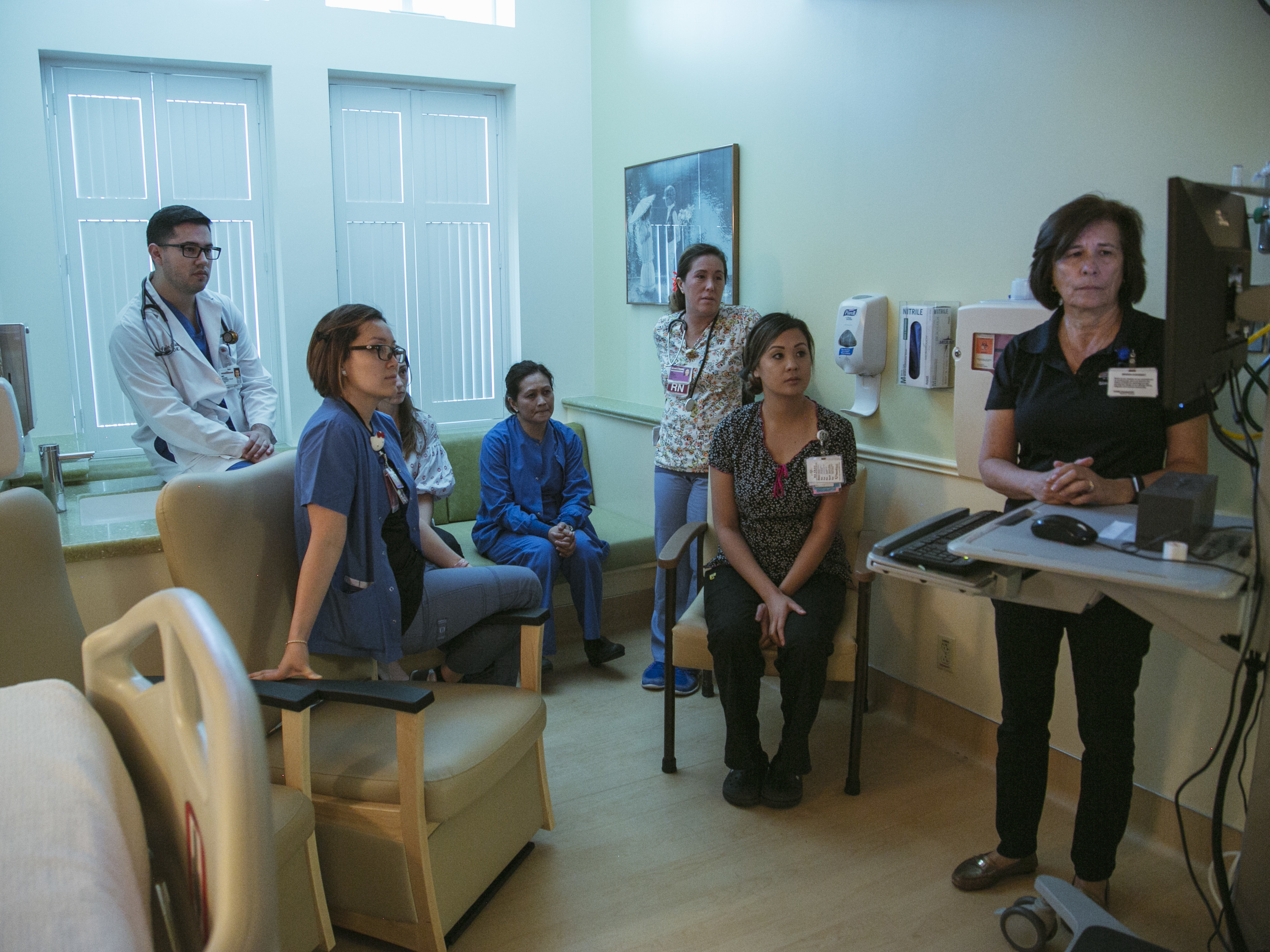 Hospital staff at Pomona Valley Hospital Medical Center review video footage of an emergency drill performed on a medical mannequin.
