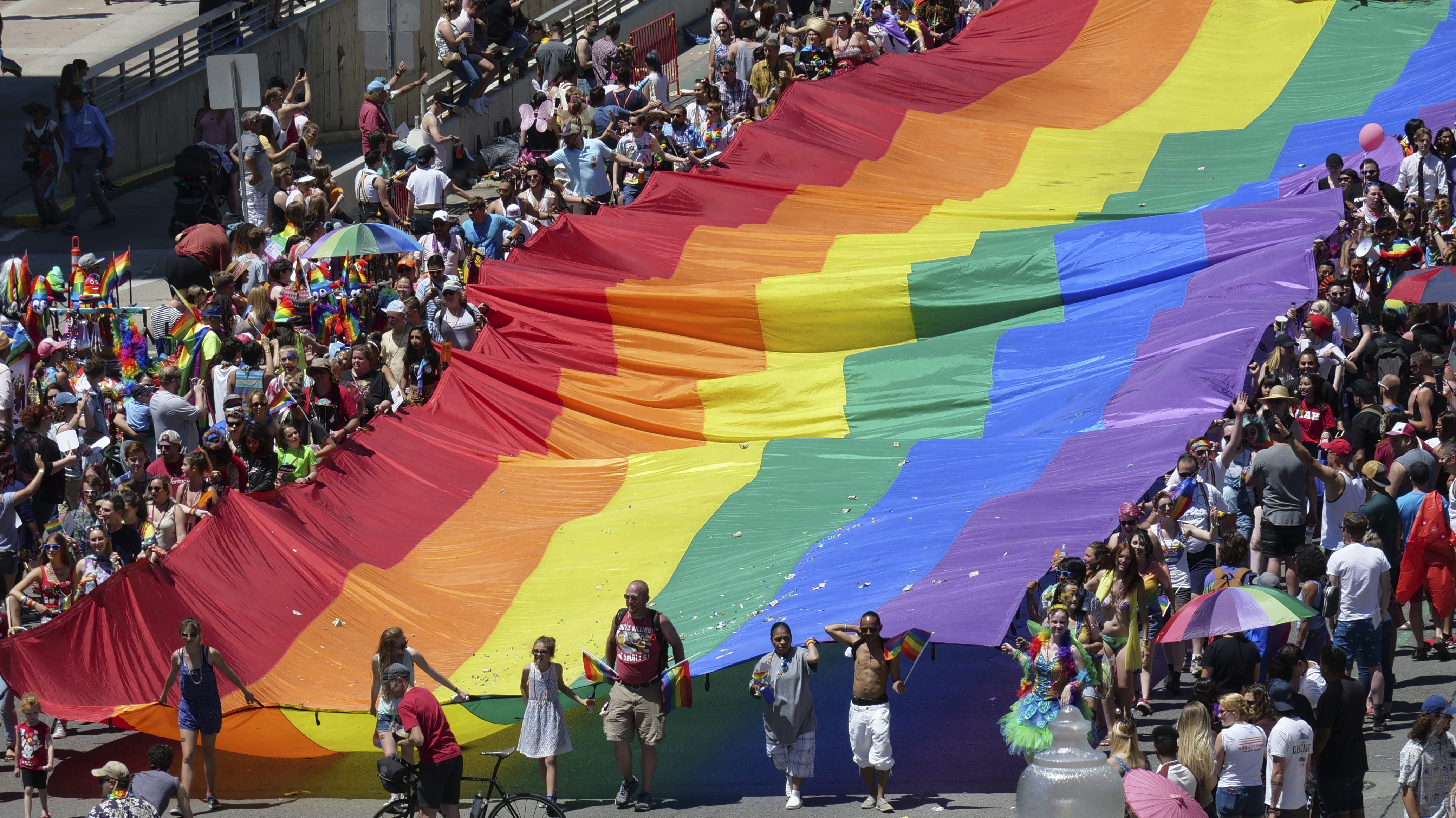 Marchers carry an LGBTQ pride flag during the Utah Pride Parade in Salt Lake City in June. The Senate bill would require the Census Bureau to protect all sexual orientation and gender identity information it collects.