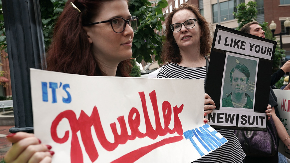 Activists hold signs — one referencing special counsel Robert Mueller — outside the Alexandria, Va., courthouse as Manafort's trial began this week. (Alex Wong/Getty Images)