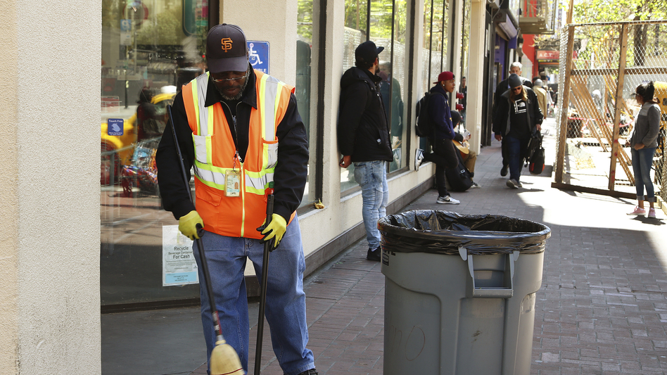 A city sanitation worker gets to work in downtown San Francisco, which says it is expecting its street cleaning budget to be more than $70 million this coming fiscal year.
