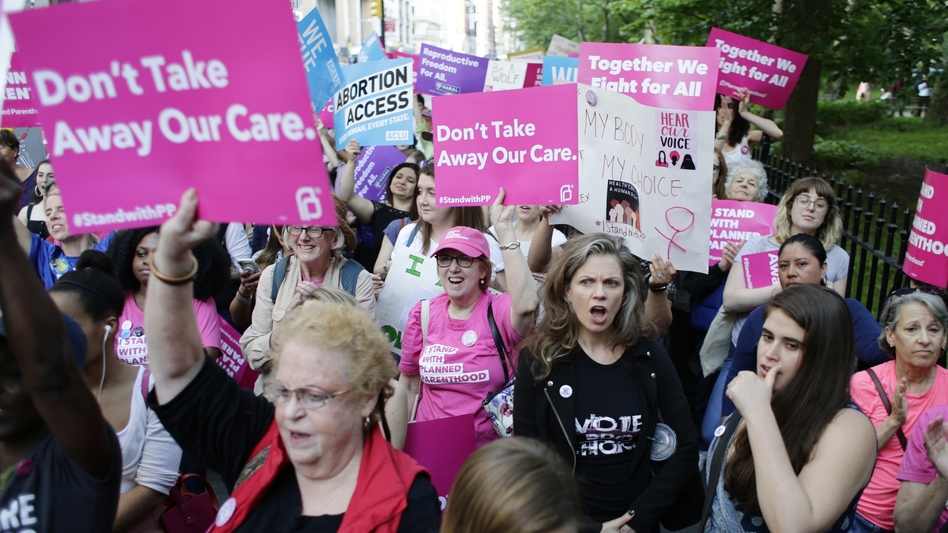 Supporters of Planned Parenthood react to speakers at a rally in New York in May. (Frank Franklin II/AP)