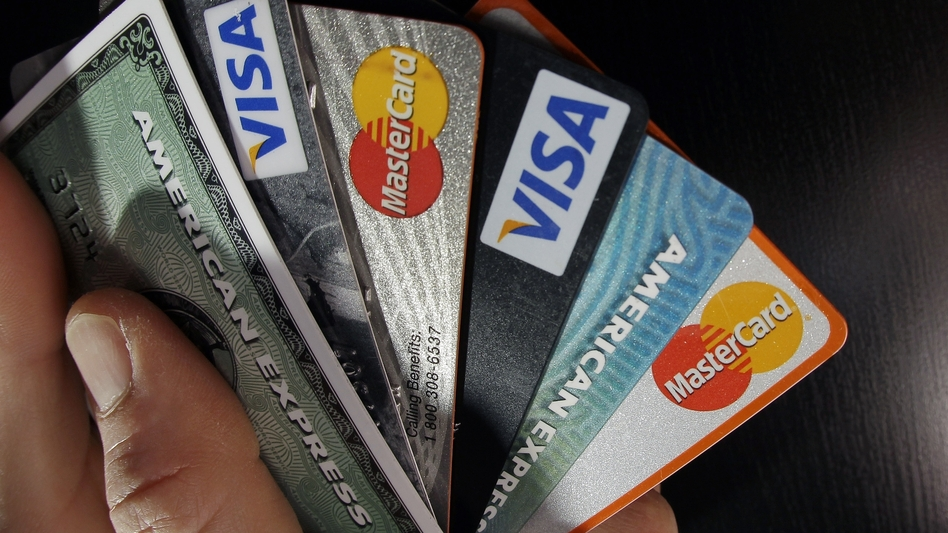 The government is acting like a spendthrift family, piling up credit card bills even though times are good. (Elise Amendola/AP)