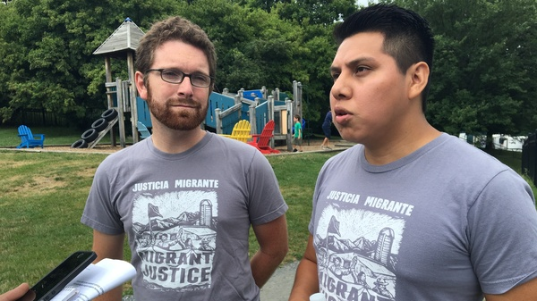 Will Lambek, left, interprets for Enrique Balcazar, a Migrant Justice activist who helped negotiate the fair labor and living standards agreement with Ben & Jerry