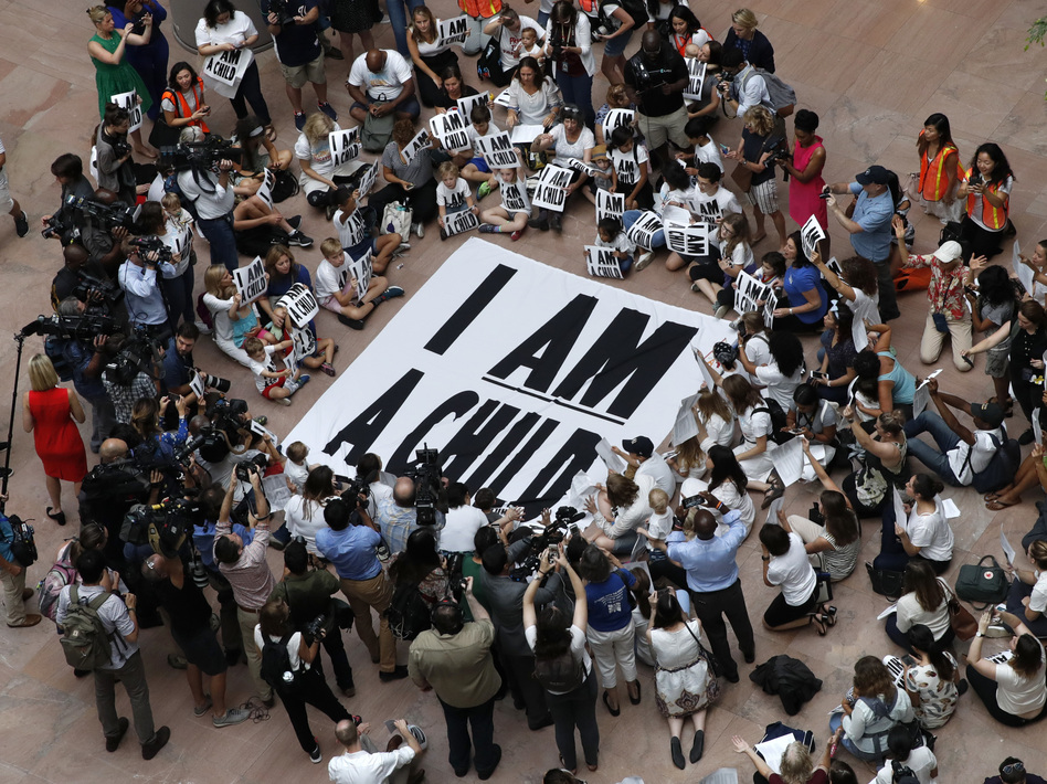 Families with young children protest the separation of immigrant families with a sit-in at the Hart Senate Office Building in Washington last week. (Jacquelyn Martin/AP)