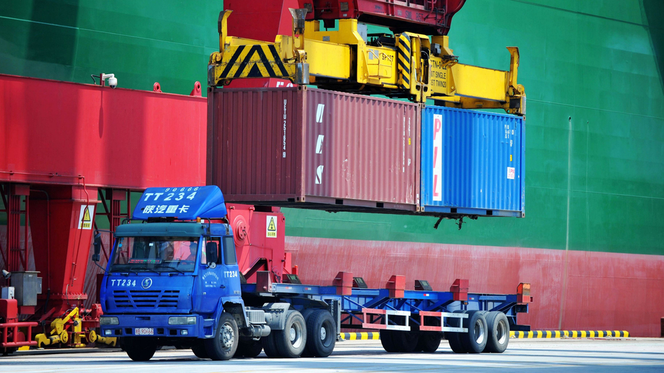 Containers are transferred at a port in Qingdao in China's eastern Shandong province on July 6. China has announced a plan to impose more tariffs on U.S. goods, in response to escalating trade threats from the Trump administration. (AFP/Getty Images)