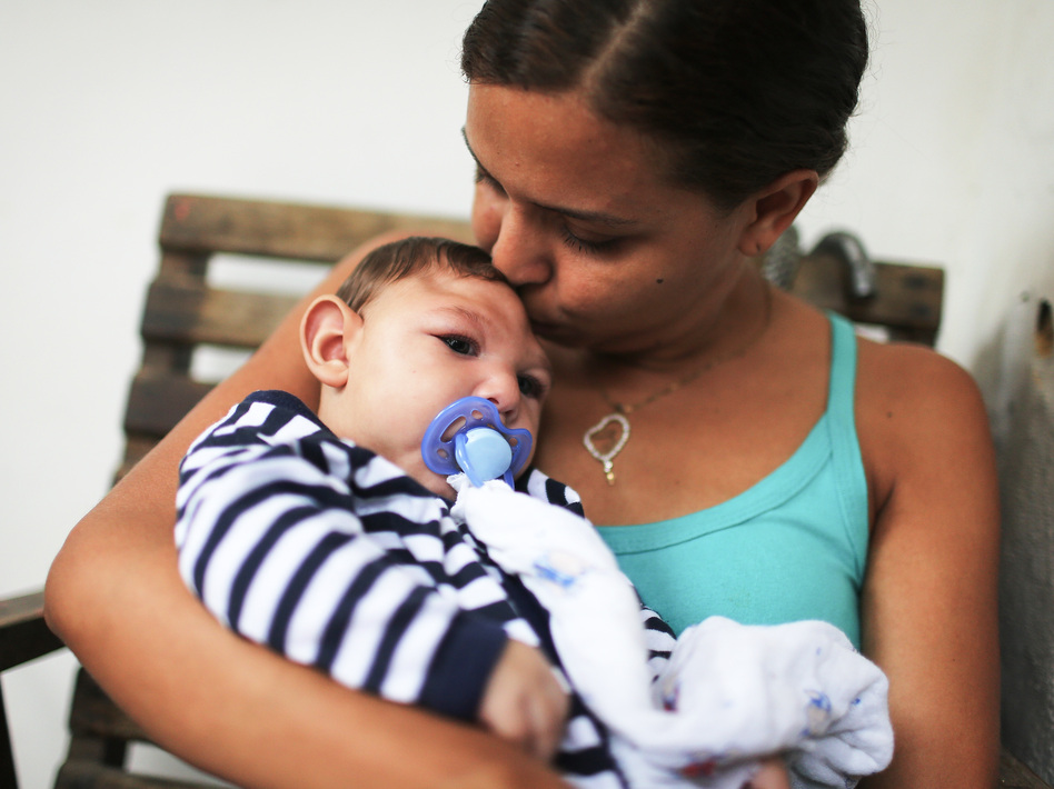 Mother Daniele Santos holds her baby Juan Pedro, who has microcephaly, on May 30, 2016, in Recife, Brazil. Researchers are now learning that Zika's effects can appear up to a year after birth. (Mario Tama/Getty Images)