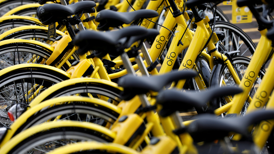 In the past year, thousands of Ofo bicycles have popped up on the sidewalks of Dallas and other cities — but the company has recently been shrinking its operations. These bikes were photographed in Singapore last summer. (Edgar Su/Reuters)