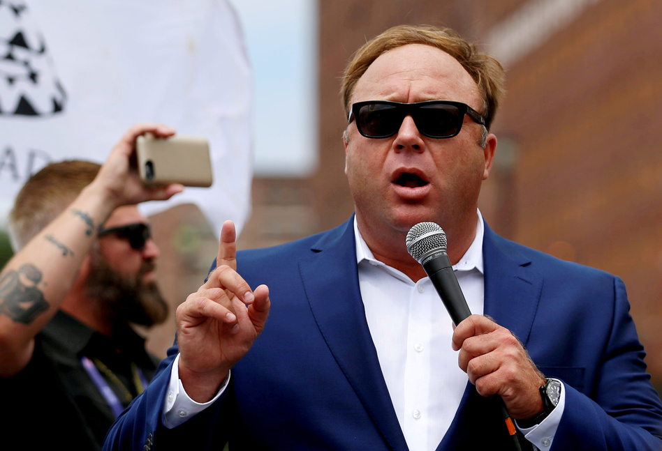 """Alex Jones, shown here at a July 2016 rally in support of then-candidate Donald Trump, says he is being subjected to a """"purge"""" from big tech companies."""