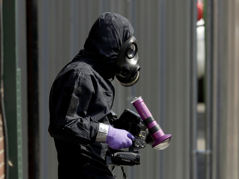 A specialist team member in a police protective suit in Salisbury, England, last month. British police scoured sections of Salisbury and Amesbury in southwest England, searching for a container feared to be contaminated with traces of the deadly nerve agent Novichok. (Matt Dunham/AP)
