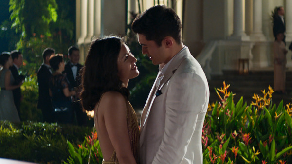 Rachel (Constance Wu) and Nick (Henry Golding) share a moment in the Singapore moonlight in Crazy Rich Asians.
