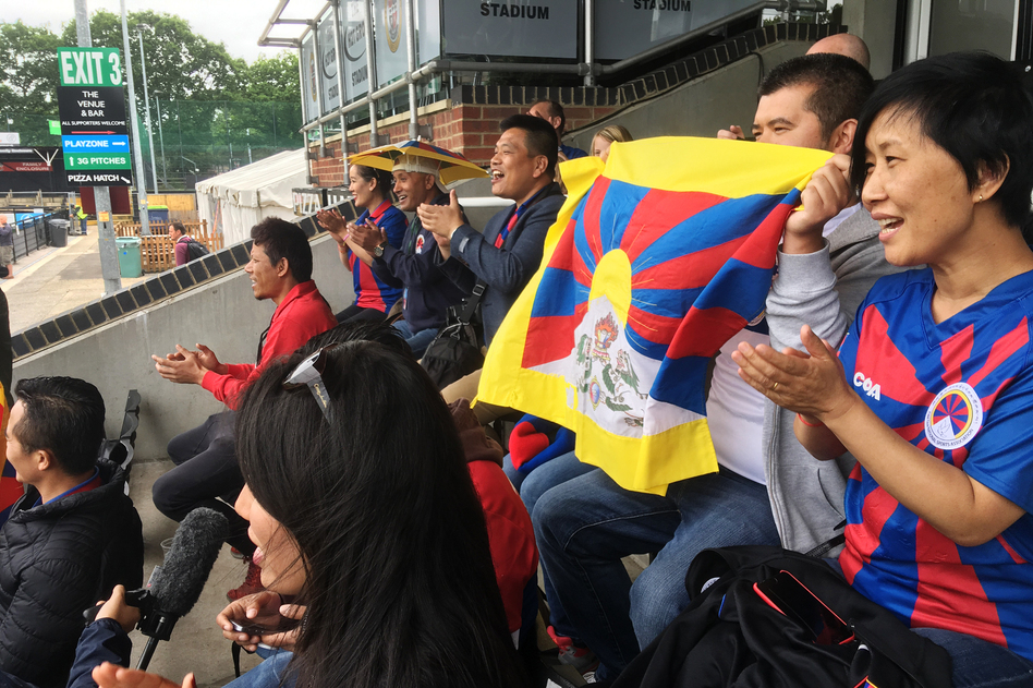Tibetans cheer on a Tibetan team at a soccer tournament in London. Fans say they were pleased and surprised that the tournament organizers didn't succumb to pressure from potential sponsors and dump the Tibetan team to avoid angering the Chinese government. (Frank Langfitt/NPR)