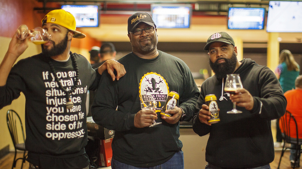 Fresh Fest co-founders Day Bracey (left) and Mike Potter (right) visit with Chris Harris, owner of Black Frog Brewery in Holland, Ohio, near Toledo.
