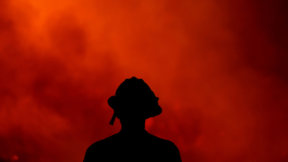 A firefighter keeps watch Thursday on the Holy Fire, which has ravaged the Cleveland National Forest in Lake Elsinore, Calif. Authorities say they believe Forrest Gordon Clark, 51, is the arsonist who set the forest ablaze. (Ringo H.W. Chiu/AP)