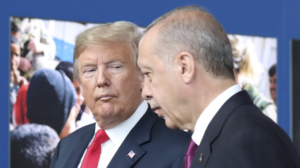 President Trump speaks with Turkish President Recep Tayyip Erdogan during a tour of the new NATO headquarters last month in Brussels, Belgium. Despite their alliance, the U.S. and Turkey have experienced escalating friction in recent weeks.