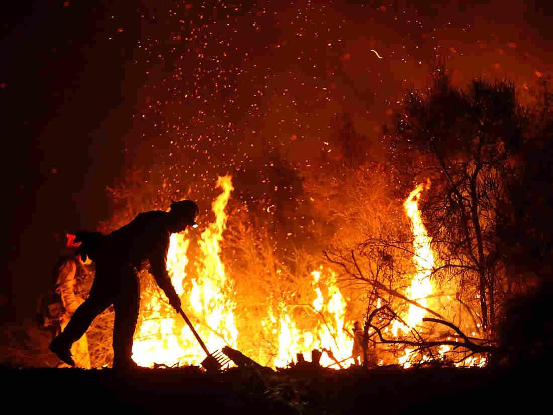 Firefighters gain on major California blazes as heat wave breaks