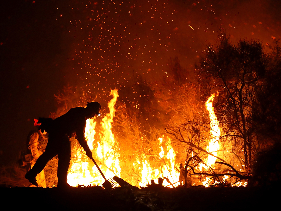 A firefighter monitors a back fire while battling the Medocino Complex fire on Aug. 7, near Lodoga, Calif. The Mendocino Complex Fire, which is made up of the River Fire and Ranch Fire, has become the largest wildfire in state history with over 344,890 acres charred. (Justin Sullivan/Getty Images)