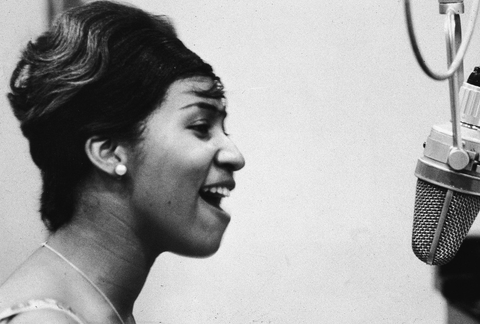 Aretha Franklin sings in the studio during during her early career at Columbia Records. (Frank Driggs Collection/Getty Images)