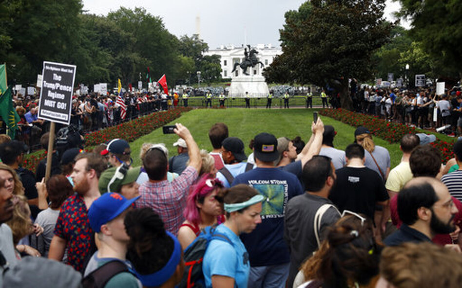 "Demonstrators rally near the White House Sunday on the anniversary of the Charlottesville ""Unite the Right"" rally. (Jacquelyn Martin/AP)"