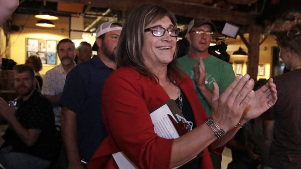 Vermont Democratic gubernatorial nominee Christine Hallquist, a transgender woman and former electric company executive, applauds with her supporters during her election night party in Burlington, Vt.