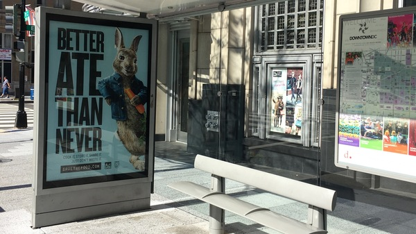 Peter Rabbit encourages people not to waste food as he casually chomps on a carrot on posters around town.