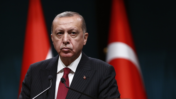Turkish President Recep Tayyip Erdogan speaks during a news conference Tuesday at the presidential palace in Ankara.