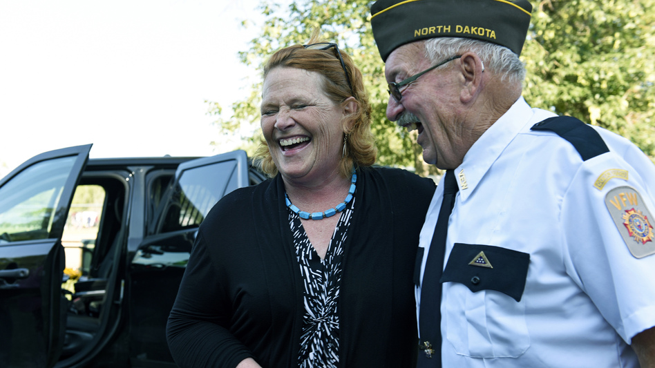 Sen. Heidi Heitkamp, D-N.D., laughs with an attendee at an event sponsored by the West Fargo Police Department on Aug. 7. Heitkamp is one of 10 Senate Democrats facing re-election in November in states President Donald Trump won in 2016. (Dan Koeck/Bloomberg via Getty Images)