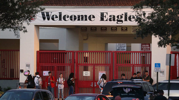 Students arrive Wednesday for their first day back at Marjory Stoneman Douglas High School, six months after the fatal shootings of Feb. 14.