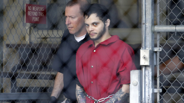 Esteban Santiago leaves the Broward County jail for a hearing in federal court on Jan. 17, 2017, in Fort Lauderdale, Fla. Santiago has been sentenced to life in prison for a Jan. 6 shooting rampage at a Fort Lauderdale-Hollywood International Airport baggage claim area.