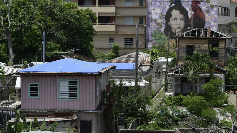Some houses affected by Hurricane Maria remained covered in tarps or missing roofs as recently as June in San Juan, Puerto Rico's El Gandul neighborhood. (Carlos Giusti/AP)