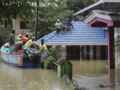Rain Starts To Slow After Flooding Displaces 800,000 In Southern Indian State