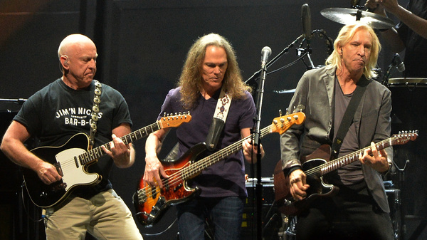 """Bernie Leadon, Timothy B. Schmit and Joe Walsh of the Eagles perform during """"History Of The Eagles Live In Concert"""" in October 2013 in Nashville."""