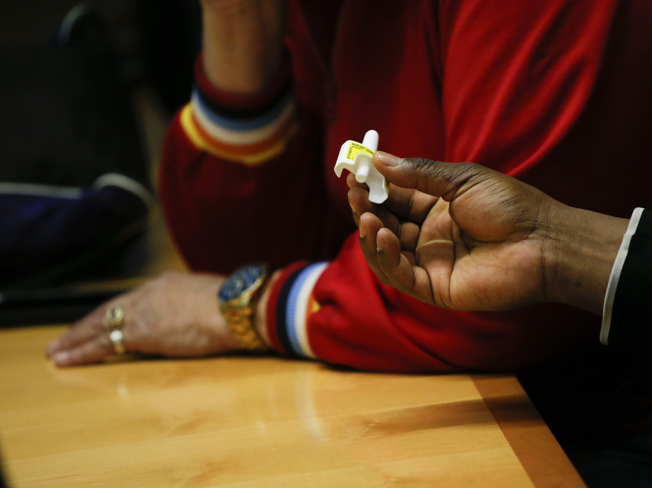 A man holds a sample of the opioid antidote Narcan during a training session at a New York City Department of Health and Mental Hygiene office in March. (Kena Betancur/AFP/Getty Images)