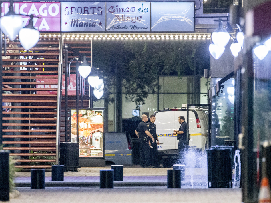 A heavy police presence remained into the night at the scene of the shooting inside Jacksonville Landing on Sunday in Jacksonville, Fla. (Mark Wallheiser/Getty Images)