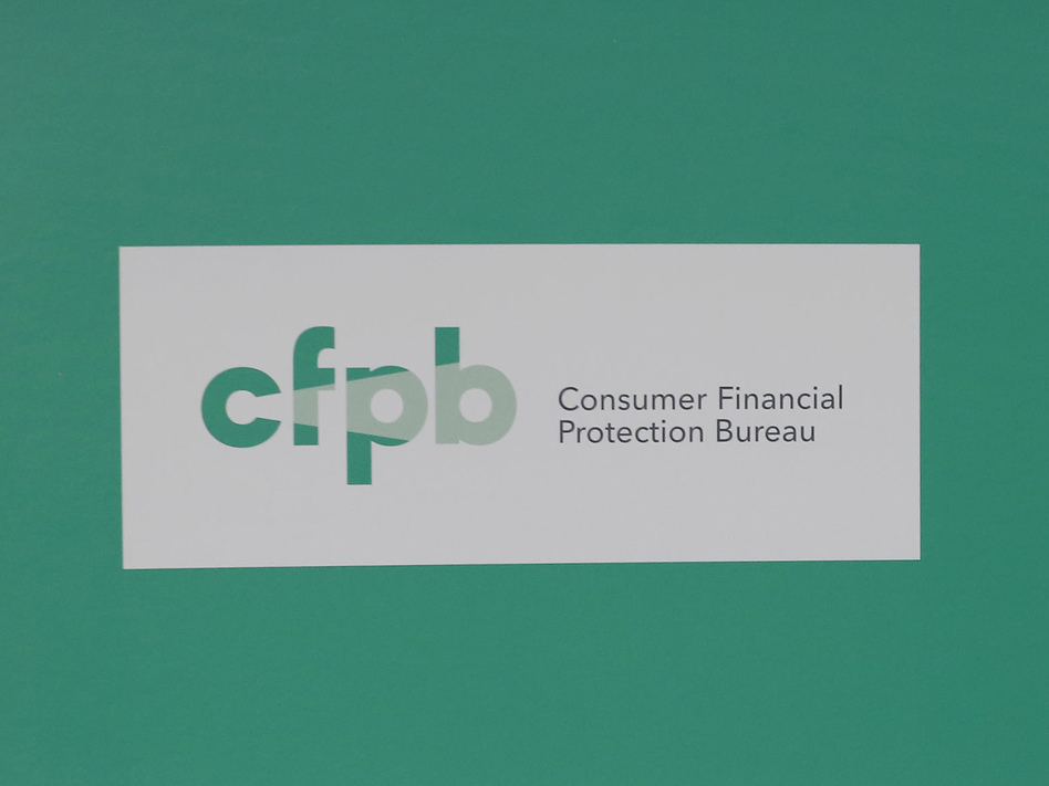 President Obama visits the Consumer Financial Protection Bureau in 2014. (Larry Downing/Reuters)