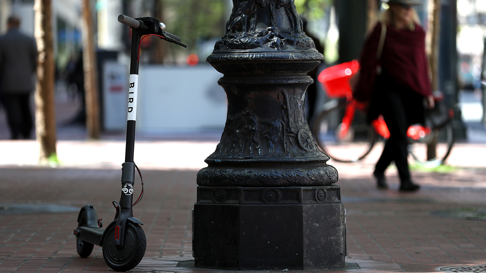 A Bird scooter sits parked on a street corner in San Francisco. Dockless scooters have become very popular across the U.S., but many people say they're a nuisance. (Justin Sullivan/Getty Images)