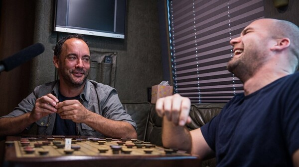 Brian Calhoun (right) makes guitars for musicians like Dave Matthews, but his newest creation is a board game called Chickapig — and he had a board custom-installed in Matthews