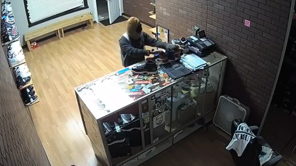 A burglar, shown in a video released by the Roanoke County Police Department, stole a selection of shoes at Clean Soles.