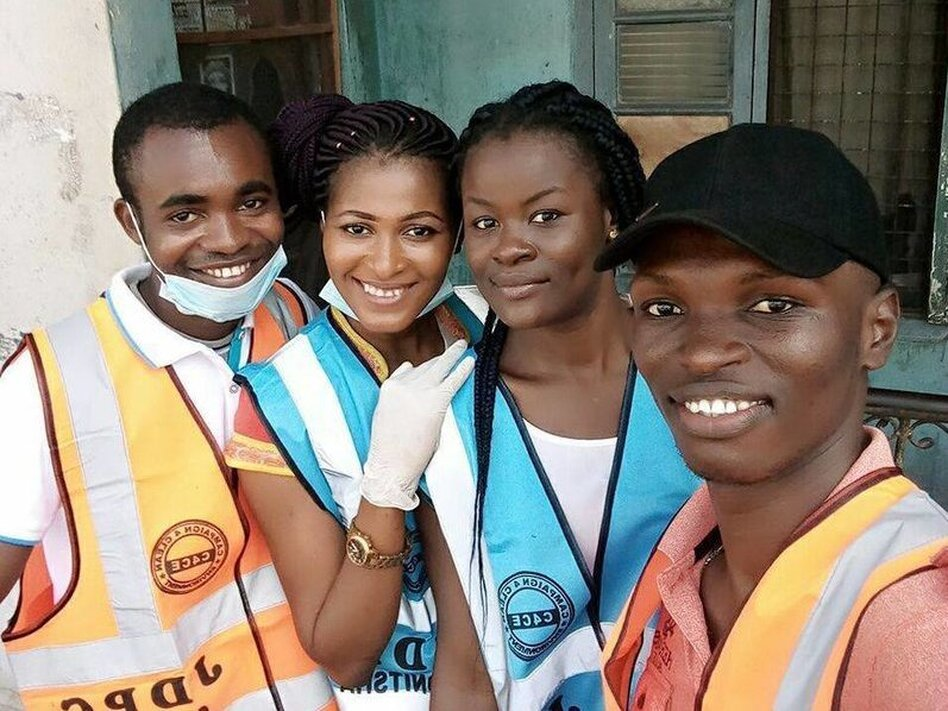Chris Junior Anaekwe, right, with three volunteers. They picked up trash in their city of Onitsha, Nigeria, for World Environment Day on June 5. (Chris Junior Anaekwe)