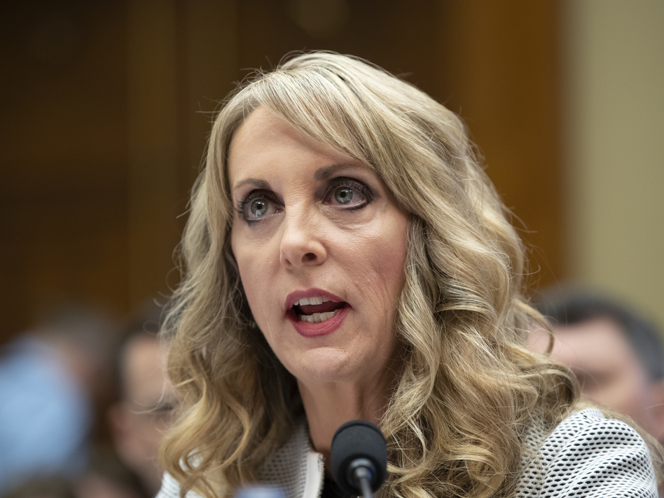 Kerry Perry, shown here testifying to lawmakers in May, has resigned from her post as USA Gymnastics President and CEO. (J. Scott Applewhite/AP)