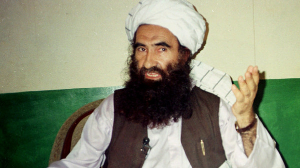 In this 1998 file photo, Jalaluddin Haqqani, founder of the militant group the Haqqani network, speaks during an interview in Pakistan. The Taliban say Haqqani, an ex-U.S. ally turned enemy, died Monday. He was 72.