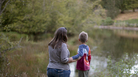 Matthew Randall, 7, and his mother, Laura, look at a beaver in the water at Mill Pond Park in Portland, Oregon.