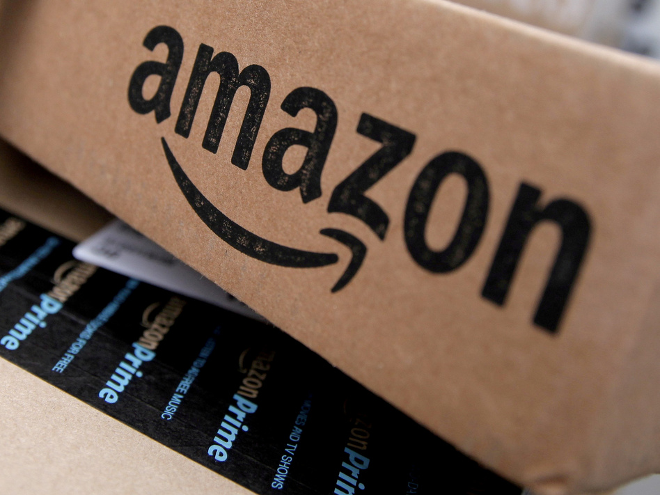Amazon's stock value briefly crossed $1 trillion on Tuesday. The giant online retailer and Web services company has been consistently profitable since 2015. (Mike Segar/Reuters)