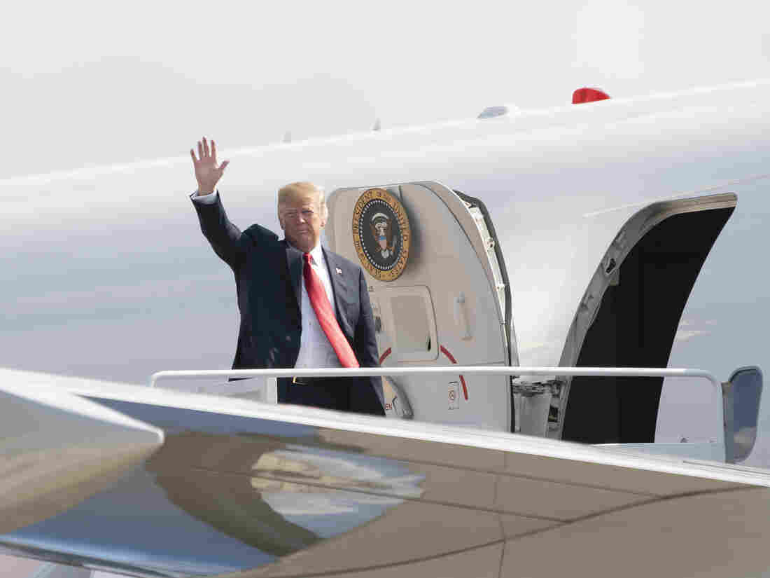 President Trump boards Air Force One headed for events in Illinois, Missouri and Iowa on July 26.