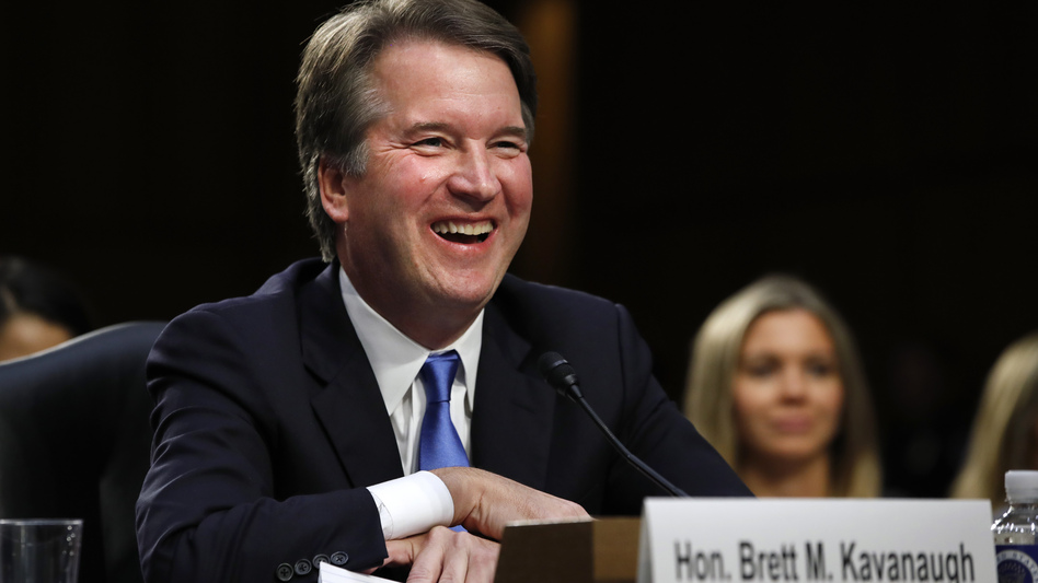 Supreme Court nominee Brett Kavanaugh laughs as closing remarks are made Wednesday evening after the second day of his confirmation hearings before a Senate panel on Capitol Hill in Washington, D.C., to replace retired Justice Anthony Kennedy. (Jacquelyn Martin/AP)