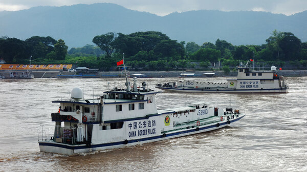 Chinese border patrol gunboats come downriver from the Yunnan province about once a month in a show of force to keep the Mekong River safe, as China