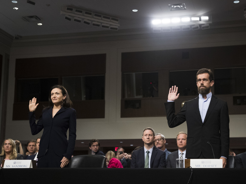 Facebook Chief Operating Officer Sheryl Sandberg and Twitter Chief Executive Officer Jack Dorsey testify during a Senate intelligence committee hearing on Sept. 5. (Drew Angerer/Getty Images)